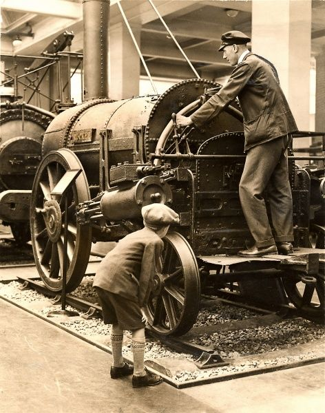 Schoolboy inspects the Rocket locomotive at the Science Museum, 1929 Date: 1929