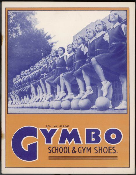 A line-up of schoolgirls with solemn faces, wearing gym- slips and gym-shoes - by 'Gymbo', of course !