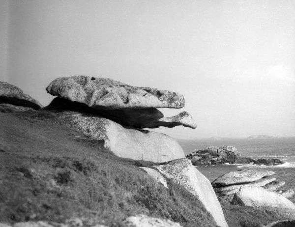'The Tortoise Rock', a strange natural rock formation at St. Mary's, Scilly Isles. Date: 1930s