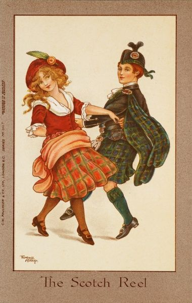 Two children dance a pretty Scottish reel dressed in traditional costume