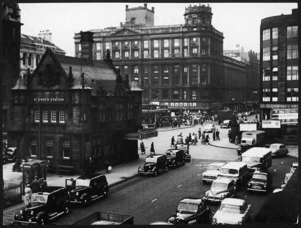 The busy St. Enoch Square, Glasgow, Scotland. The building on the left is the subway (underground) station