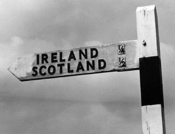 Scotland and Ireland have never been closer together than on this signpost seen in Wiltshire, England! Date: 1960s