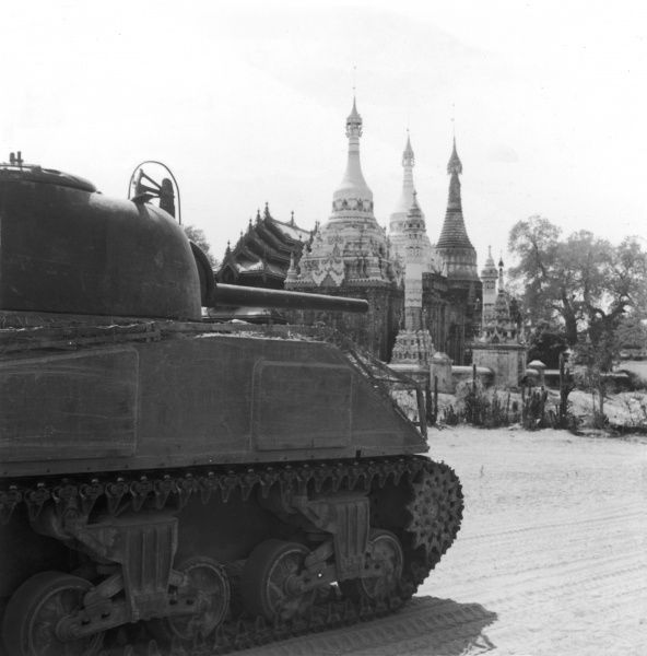 Scottish tank crew in Burma, 15th March 1945. A Sherman tank passing a pagoda on the Taungtha road