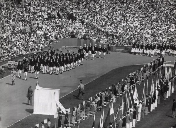 Scout holding the Great Britain sign in front of the British atheletic contingent to the 1948 London Olympics at Wembley Stadium