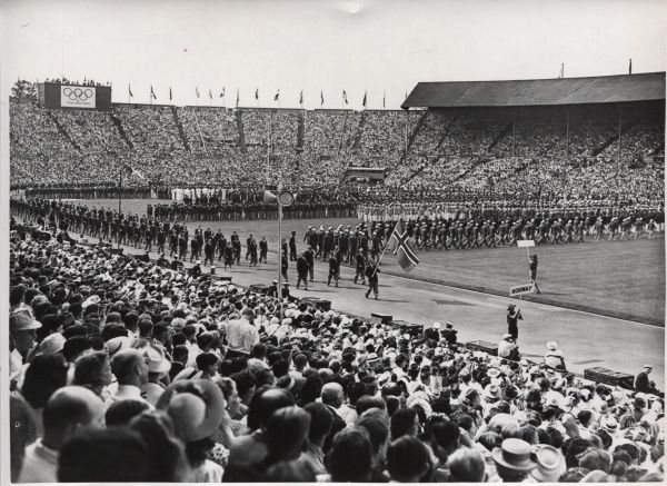 Scout holding the Norway sign in front of the Norwegian atheletic contingent to the 1948 London Olympics at Wembley Stadium
