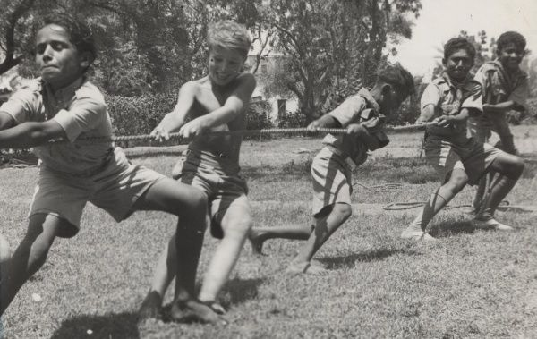Pulling Together. Native Scout visitors and boys of the 1st Khormaksar Troop in a tug of war at Sheik Othman, Aden