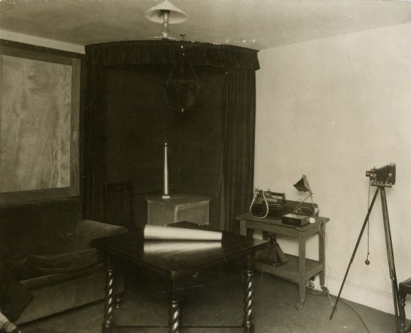 Undated photograph of corner of the sance room at the National Laboratory of Psychical Research, with 'trumpets' on table. HPG/1/2/1 (vi)