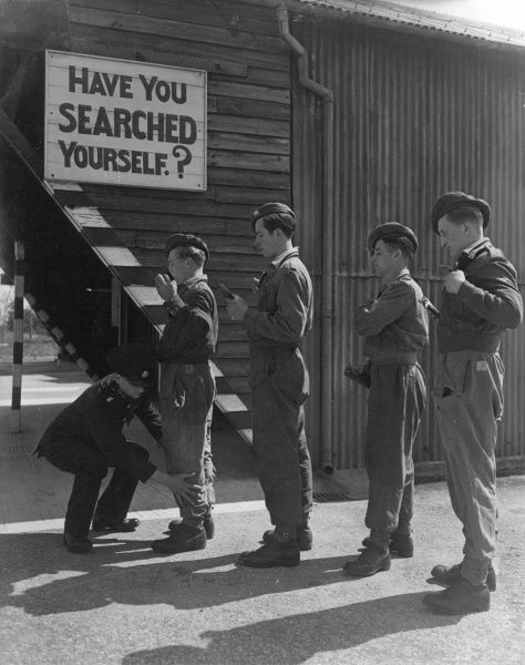 Four soldiers lining up for inspection, below a sign which reads: Have You Searched Yourself?