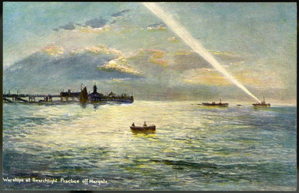 Warships of the Royal Navy engaged in searchlight practice off the Kent coast at Margate