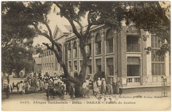 Street scene outside the Courts of Justice : a few French colonials can be discerned among the crowd