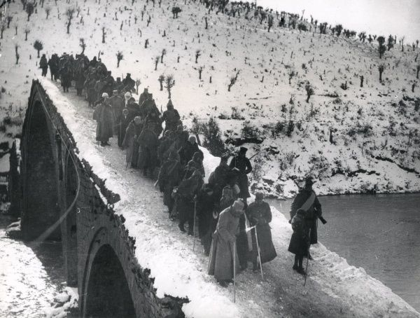Serbian headquarters staff retreating to Albania during the First World War. They are crossing a bridge near the village of Sizir. Date: October 1915