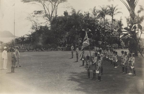 His Excellency de Symons Montagu George Honey C.M.G., Governor & Commander-in-Chief of the Seychelles addresses the Scouts after presenting them with their Colours at Government House, Seychelles. 23 scouts are on parade