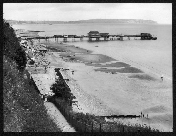 A view of the sea front and pier at Shanklin, Isle of Wight, with Culver Cliff in the distance