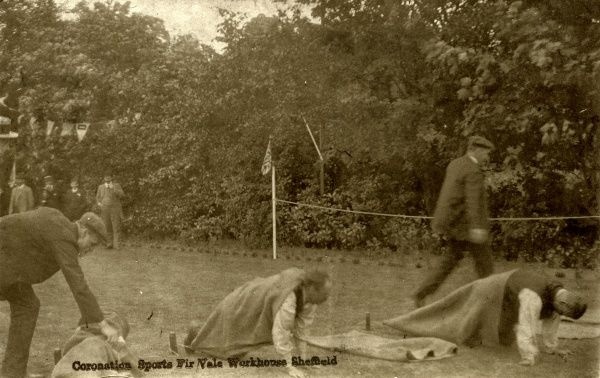 A sack race during 'Coronation Sports' at the Sheffield Union workhouse at Fir Vale, Sheffield. Date: circa 1911