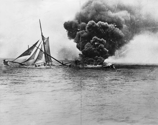 A ship on fire in mid-ocean in an unknown location during the First World War. Date: 1914 -1918