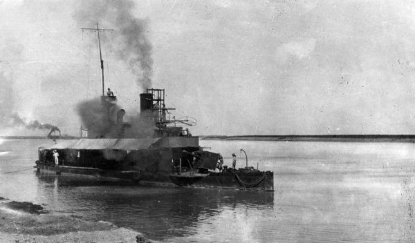 A ship firing towards the coast, probably somewhere in the Middle East during the First World War. Date: 1914-1918