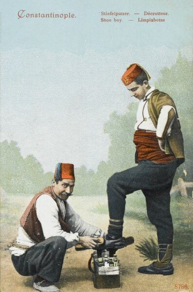 Turkish shoeshine boy (or in this case man!) brushes his clients boots to a gleaming finish