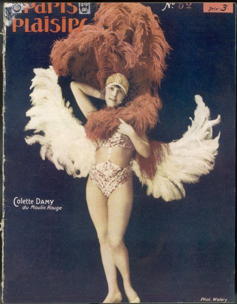 Colette Damy poses in her costume of many feathers