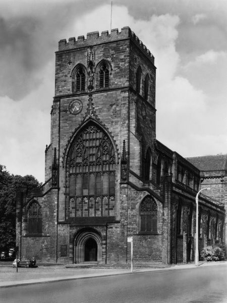 The West Front of Shrewsbury Abbey, Shropshire, England, with its fine perpendicular window above the Norman West Door. Founded by Roger de Montgomery in 1083. Date: founded 1083