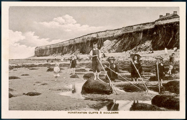 A group of children shrimping among the Boulders on the beach at Hunstanton, Norfolk
