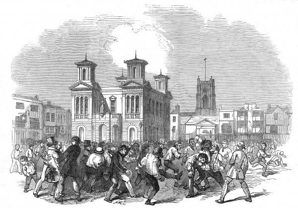 Engraving showing the traditional game of football, played on Shrove Tuesday, in the marketplace of Kingston-Upon-Thames. This match was played between the 'Thames-Street Club' and the 'Townsend' team, starting at 11am and finishing at 5pm