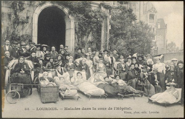 Sick pilgrims waiting in the courtyard of the hospital at Lourdes to be taken to the Grotto where, if the Virgin chooses, they will be cured
