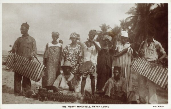 A band with marimba players and a drummer - captioned as 'The Merry Minsterls' - Sierra Leone, West Africa Date: circa 1910s