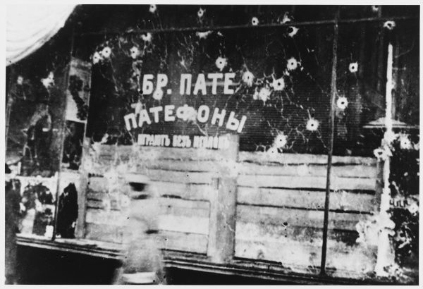 Bullet-holes in a Moscow shop window testify to the fierce fighting which took place before the Bolsheviks took over the city