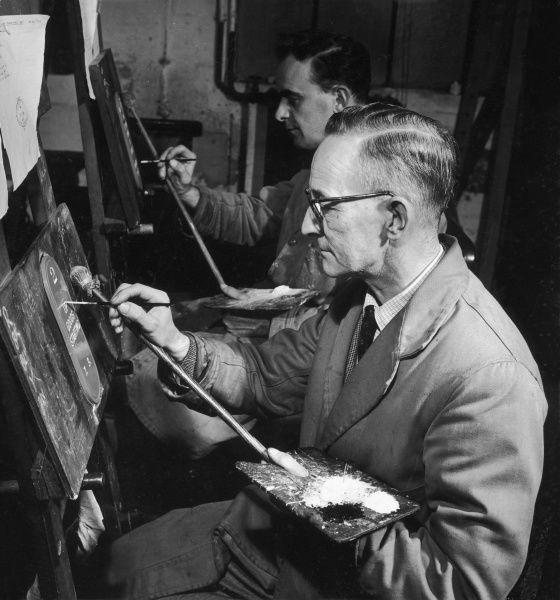 A wonderful photograph by Heinz Zinram showing a master signwriter at work, with his younger collegue (or apprentice) behind. A study in concentration, accuracy and exactitude in the craftsman's art