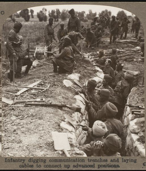 Sikh infantry in the British army digging communication trenches and laying cables to connect up advanced positions
