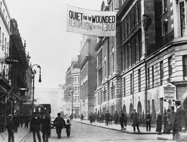 A Quiet for the Wounded sign for traffic hanging outside Charing Cross Hospital in London during World War I