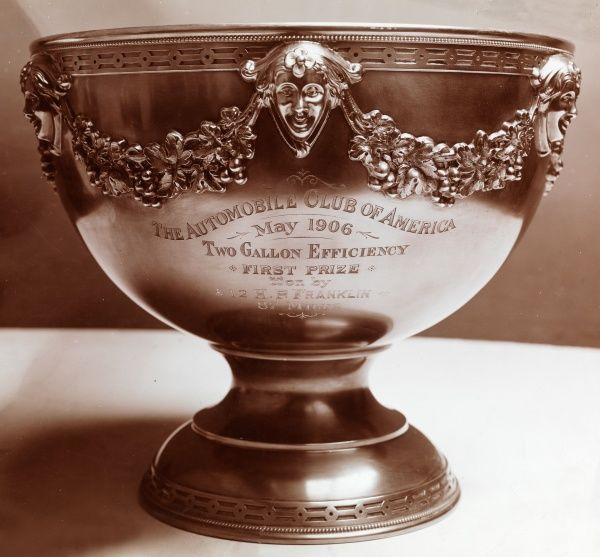 Autos, Decauville Auto Co., 2 gallon efficiency cup. Silver trophy cup engraved: The Automobile Club of America,May 1906, Two Gallon Efficiency First Prize Won By 12 H.P. Franklin