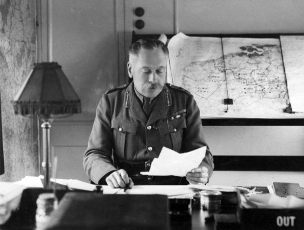 Field Marshal Sir Douglas Haig (1861-1928) in his headquarter train in France during the First World War, with maps of France and Belgium behind him. Date: circa 1918