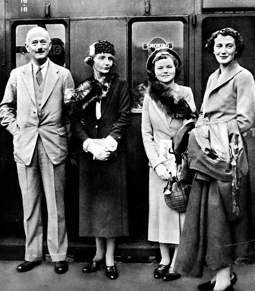 Photograph showing Sir Hughe Knatchbull-Hugessen (1886-1971) (on left), then British Ambassador to China, pictured with his family, c.1937. Elizabeth Knatchbull-Hugessen is seen on the right of the image