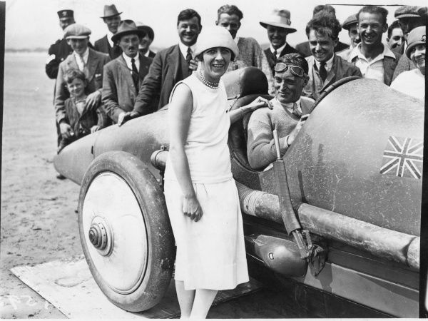 Photograph showing Sir Malcolm Campbell (1885-1948) and Lady Dorothy Evelyn Campbell (nee Whittall) after a successful world land speed record attempt on Pendine Sands, Carmarthenshire, 1925