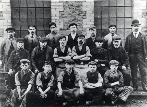 Workmen and apprentices of the Skewen Colliery repair shop in Glamorgan, South Wales, in a group photograph
