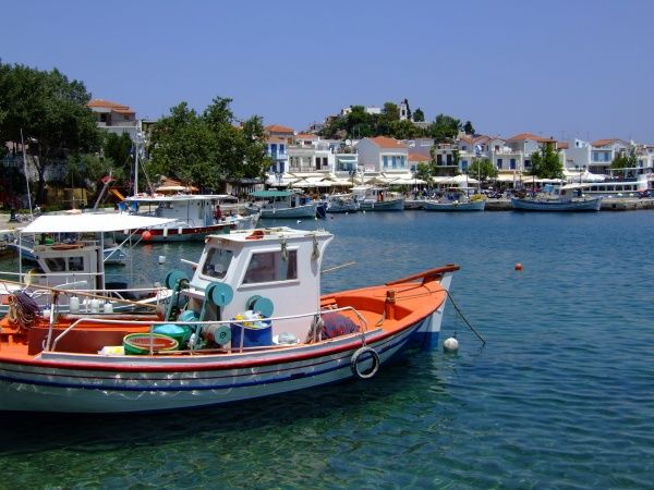The busy harbour of Skiathos Town, Skiathos. Fishing boats and tour boats line the harbour