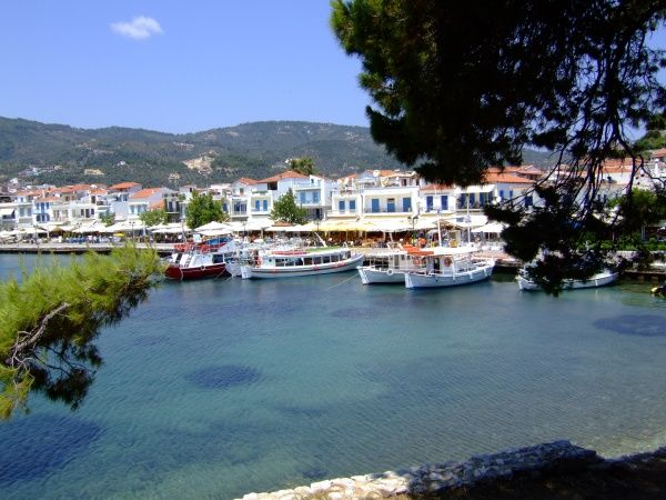 Skiathos Town, Skiathos, Greece. Fishing boats, tour boats and fish restaurants line the harbour
