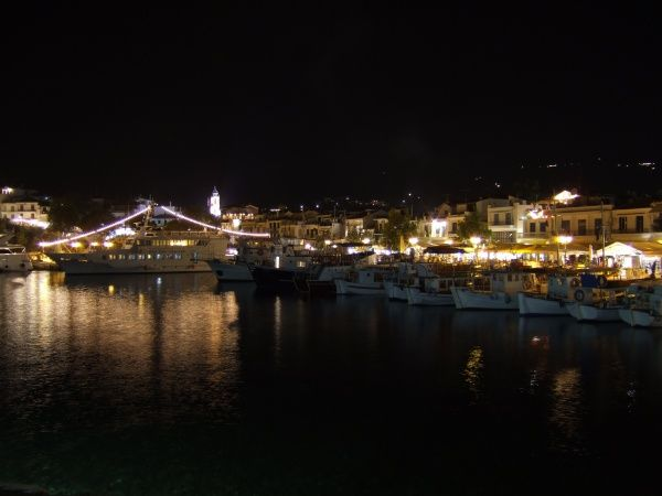 Skiathos Town, Skiathos, Greece. Night falls and the bars and restaurants come alive