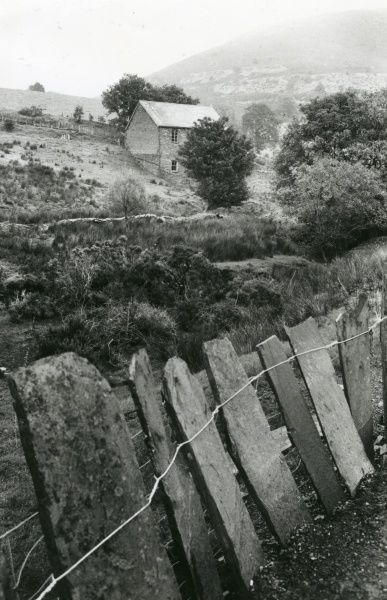 View of a fence made of slate, and a chapel building in the middle distance, in the village of Corris, in the historic county of Merionethshire, Gwynedd, North Wales