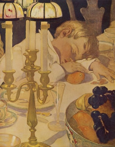 A little boy falls fast asleep at the dinner table