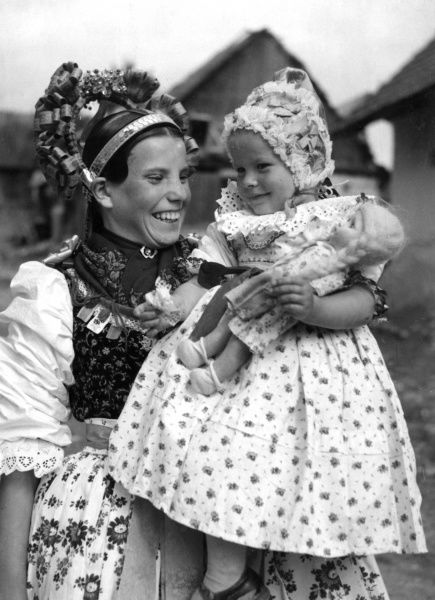 A young Slovakian mother and child in traditional dress. The Slovaks are a farming people who speak a different language than the Czechs. Date: 1930s