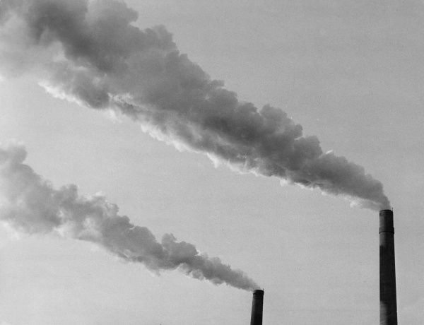 Smoking factory chimneys... Date: 1930s