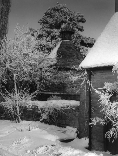 A covering of winter snow for the old dovecote (built 1320) at Upper Harlestone, Northamptonshire, England. Date: 1960s