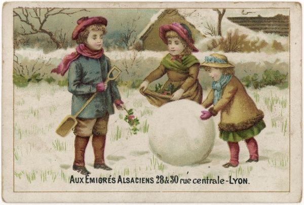 Three children with an elegantly spherical snowball