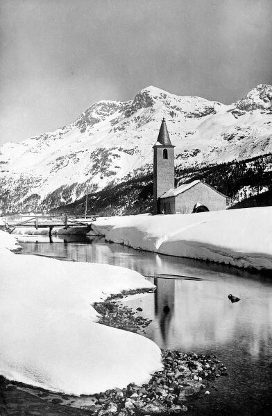 A 'picture postcard' Swiss village, with a pretty church, covered in snow, near Berne, Switzerland. Date: 1930s