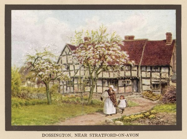 Cottage at Dossington near Stratford-on-Avon, Gloucestershire, with trees in blossom