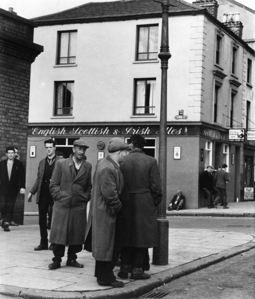 A group of men outside a pub in Dublin Date: 1950s