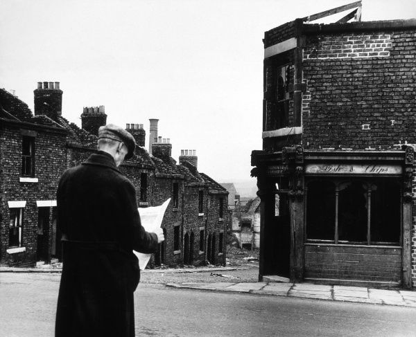 A man reading a newspaper in a Newcastle street Date: 1963