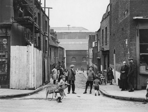 Working class children playing in a cobbled street in Wapping, east London